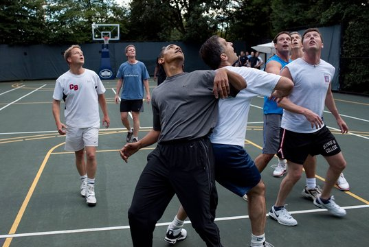 President Barack Obama along with members of Congress and Cabinet secretaries jockeys for a rebound during a basketball game on the White House court Oct. 8 2009