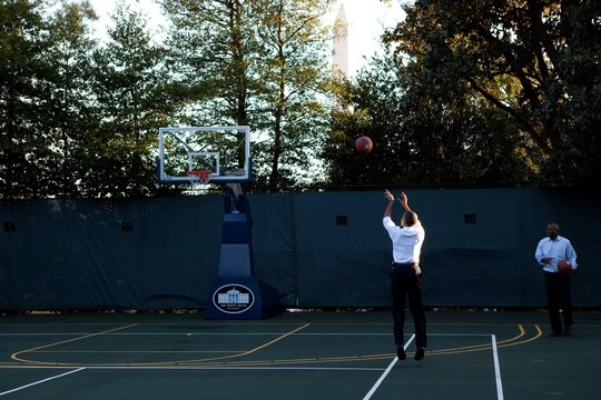 President Barack Obama shoots hoops with his personal aide Reggie Love at the White House basketball court Jan. 18 2010