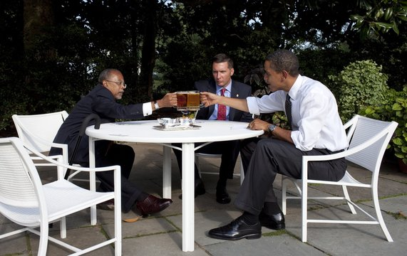 President Obama Professor Henry Louis Gates and Boston Police Sergeant James Crowley toast at the start of their reconciliation meeting in the Rose Garden of the White House