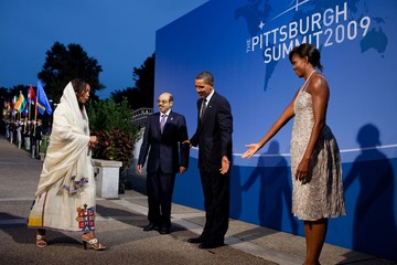 President and Michelle Obama receive Prime Minister Meles Zenawi of Ethiopia and his wife Azeb Mesfina to the G-20 economic conference in Pittsburgh.Michelle wears a dress of ikat printed silk in grey and pink from Thakoon's 2010 resort collection. Sept