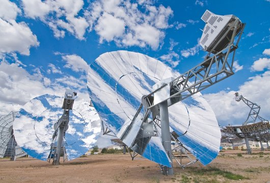 Four newly designed solar power collection dishes at Sandia National Laboratory in 2009