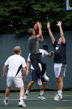 President Barack Obama takes a shot during a game with Cabinet secretaries and members of Congress on the White House basketball court Oct. 8 2009