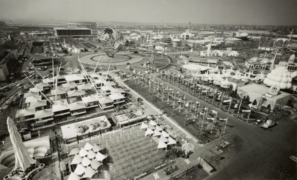 Aerial view of Unisphere and other exhibits at New York World's Fair in 1964. In the far background is the then new Shea Stadium
