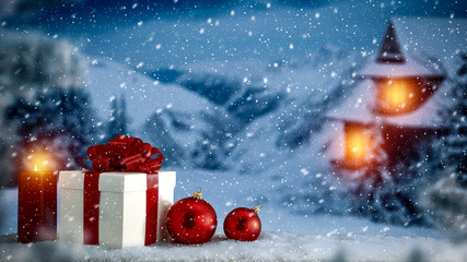 Christmas boxes with gifts of snowdrift are waiting for Christmas Eve dinner. Red ribbon and bow. Scene in front of Santa's house. Fir branches covered with frost. Red candles with warm light.