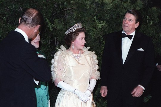 Queen Elizabeth II and Prince Philip stand with President and Mrs. Reagan during a state dinner