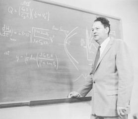 Harry Julian Allen (1910-1977), aeronautical engineer.On the blackboard is an illustration of his Blunt Body Theory used in the design of the heat shields that protected space capsules re-entered the Earth's atmosphere. Dec. 12, 1957
