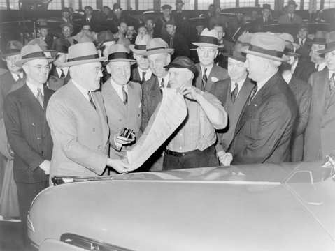General Motors executives commemorate the production of GM's 25,000,000th car, 1940