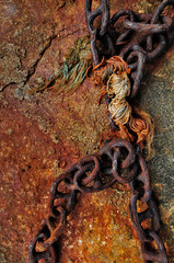 piece of old rusty of ship chain on quay