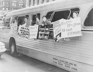 Supporting the Freedom Riders.Members of the 'Washington Freedom Riders Committee,' hang signs from bus windows to protest segregation. New York City, May 30