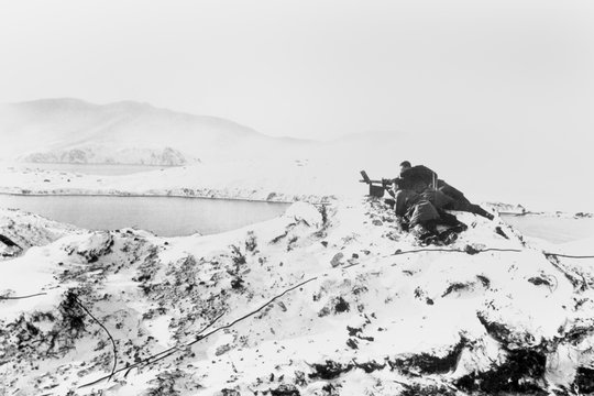 U.S. Marines man a machine gun at a lookout post in the Aleutian Islands, Alaska. Japanese