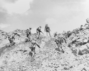 Marines making a direct frontal attack on a Japanese postion on Iwo Jima, Feb. 1945