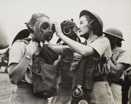 South African Women's Auxiliary Services sergeant is fitted with a gas mask. Unknown location