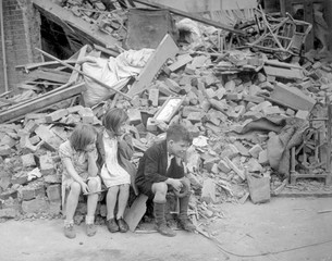 World War 2, Battle of Britain.Homeless children sit outside the wreckage of their home in London's East End, Sept. 1940