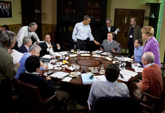 Barack Obama hosts a G8 Summit working session in the dining room of Laurel Cabin at Camp David
