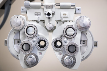 close up on eyesight testing equipment in an Optometrists office, optical phoropter background