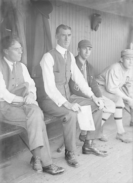 Connie Mack, manager of the Philadelphia Athletes in a dugout during a 1915 game in Washington, DC