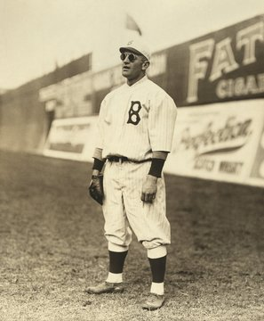 Casey Stengel, wearing sunglasses, while playing outfield for the Brooklyn Dodgers, c. 1915