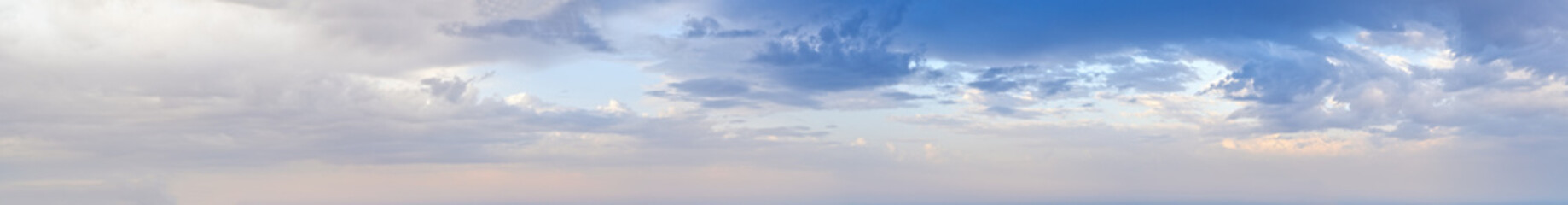Blue morning sky with clouds (wide high resolution background panorama).
