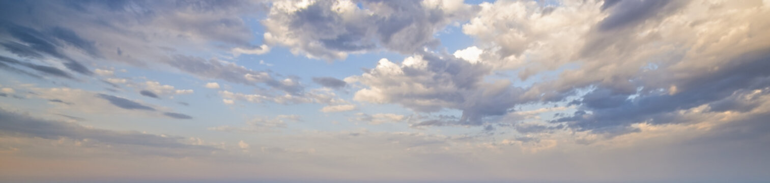 Blue morning sky with clouds (wide background panorama).