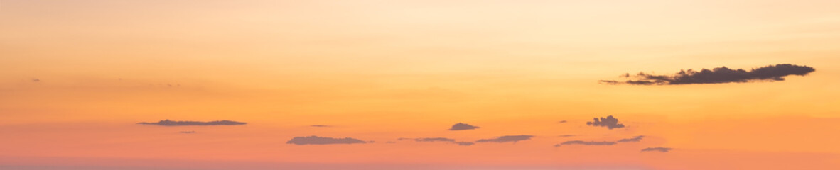 Wall Mural - Evening sky with clouds in yellow colors (wide background panorama).
