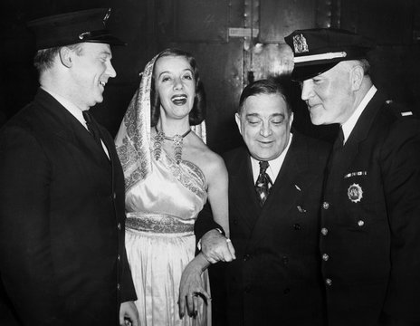 Fiorello LaGuardia, with fireman John Cocoman, opera star Lily Pons, and Lt. Thomas J. Sheehan