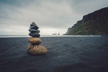 Photo sur Plexiglas Zen pierres a sable Stones on lava sand beach in Iceland.