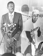 Pitcher Leroy 'Satchel' Paige (1906-1982), standing beside a picture of himself as he is receiving recognition for outstanding achievements in the Negro Baseball League, February 9, 1971