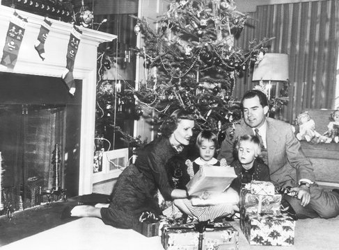 The Nixon family on Christmas Eve: Pat Nixon, Julie Nixon, Tricia Nixon, and Vice President Richard Nixon, Washington DC, December 24, 1953