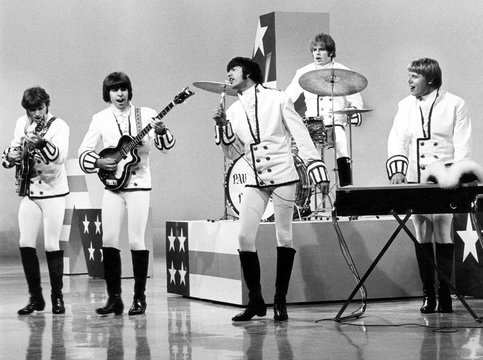 Paul Revere & the Raiders, Phil Volk (second from right), Mark Lindsay (center), Mike Smith (second from right), Paul Revere (right), performing, circa 1967