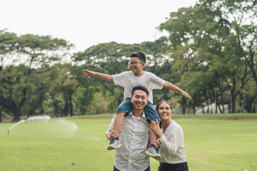 happy family running in the park, family asian group relation quality healthy support, home park .