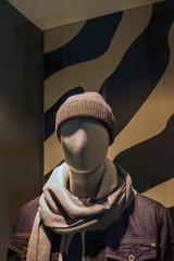 Male mannequin in knitted hat and scarf