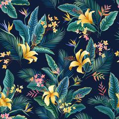 motif floral sans couture. motif tropical floral tropical avec des feuilles d& 39 hibiscus et de palmiers sur bleu foncé