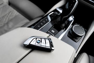 Helsinki, Finland, November 4, 2019: Close up of modern wireless keys of BMW 650i 2019 in white leather car interior. Modern Car interior details. Car inside