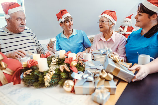 Christmas with presents in the nursing home with seniors