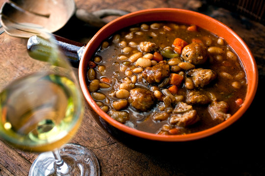 Close up of white bean and sausage stew in bowl