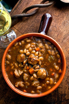 Overhead view of white bean and sausage stew in bowl