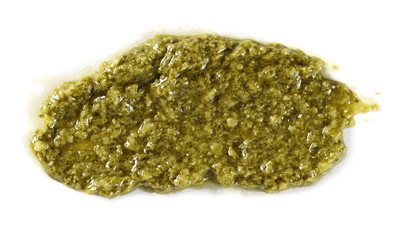 Basil paste isolated on white background, top view