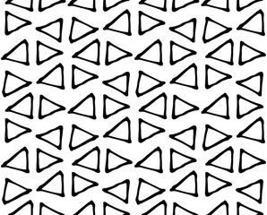 Black and white geometric abstract background. Seamless abstract doodle triangle geometrical print. Ethnic, tribal african in Doodle style. Boho paper, textile print. Repeated triangles ornament