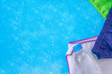 Accessories for swimming pool on a blue background