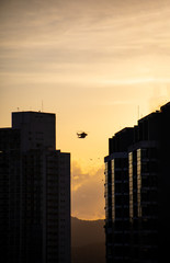 Helicopter flying in Panama City over City at Sunset