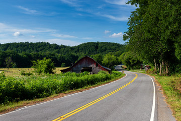 An old wood barn along a country road in rural Tennessee, USA