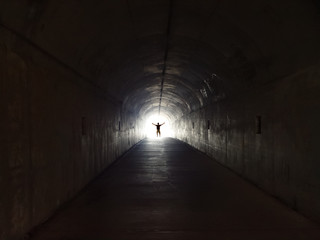 Keuken foto achterwand Tunnel Man floats at the light of a tunnel