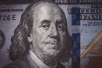 The texture of the fragment of the dollar bill. fragment of one hundred American dollars. Can  inform about fiscal and monetary policy of the country, currency inflation rate and cross currency rate,