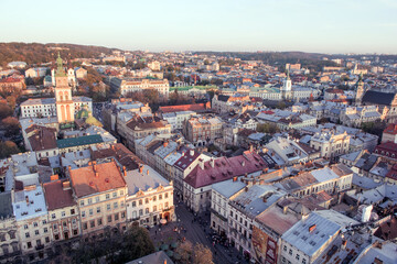 Fototapeta Lviv, Ukraine - October 24, 2019: Beautiful Ratusha view of the Assumption Church and the historic center of Lviv, Ukraine, on a sunny evening. Roofs and streets