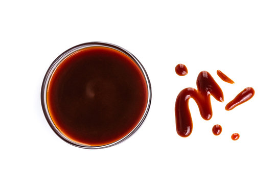 Dark red sauce in bowl dripping isolated on white background, for shrimps or fish, top view