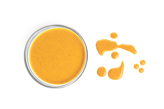 yellow sauce in bowl dripping isolated on white background, for shrimps or fish, top view