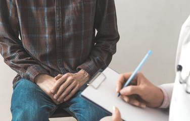 Male patient sits at the doctor's consultation. The problem of the prostate cancer. Std