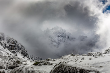 Summit in the clouds with dramatic sky at the Rila mountain in Bulgaria, Maliovica.