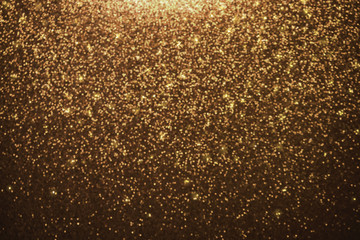 Abstract gold glitter lights background. defocused