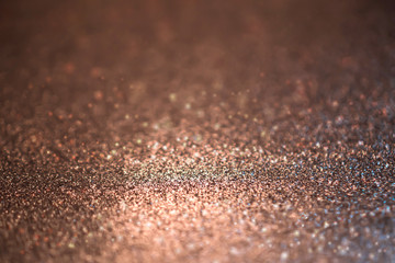 Copper glitter abstract bokeh background.